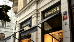 Luxury store (exterior) with people - Rolex watch Stock Footage