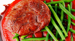 Meat medalion on green beans Stock Footage