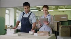 Counting Packages Stock Footage
