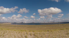 vehicle shot - view from sea dike and artificial dune at reclaimed land - stock footage