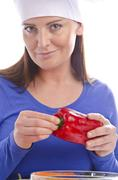 Woman with paprika and cucumber - stock photo