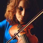 violin playing violinist musician. woman classical musical instrument player  - stock photo