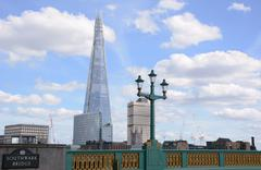 the shard from southwark bridge in london, england - stock photo