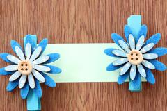 Hairpins of blue flower pattern and note paper. Stock Photos