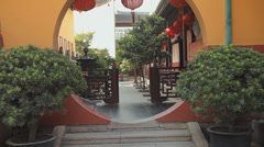 Walking through inner yard of a buddhist temple in Shanghai Stock Footage