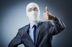 Man covered in medical bandages - stock photo