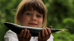 Boy holding a marine fish.Child preparing fish.Little cook. Stock Footage