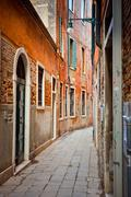 Narrow street in Venice Stock Photos