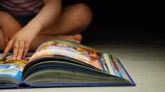 Child flipping book Stock Footage