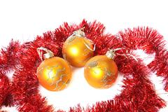 Golden christmas balls and red tinsel. isolated on white Stock Photos