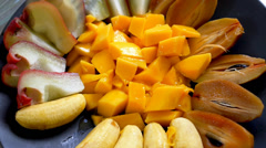 Eating Exotic Fruits from the Plate, Close up, High-Speed Camera Stock Footage