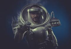 Stock Photo of intelligence, robot man in space armor silver
