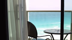 Hotel balcony with ocean waves in background Stock Footage
