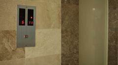 Elevator stops at floor and door opens - stock footage