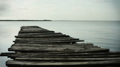 Old boat dock with broken boards selective focus - stock footage