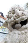 Lion statue outside temple in Hong Kong - stock photo