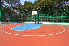 Basketball court in sunny day - stock photo