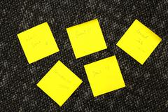 Yellow memo papers with business wordings: Good Job, Deal, Great Stock Photos
