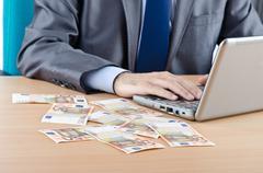 Man with euro banknotes Stock Photos