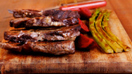 Stock Video Footage of grilled beef pork meat with asparagus on wood