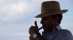 Man smoking Cigar.  Silhouette - stock footage