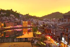 Fenghuang ancient town in Hunan Province at sunset time - stock photo