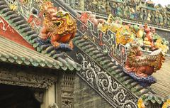 Roof of Chinese temple with stone lions - stock photo