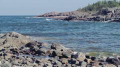 Rock Filled Swedish Fjord Coast Blue Sea Sunny - 29,97FPS NTSC Stock Footage