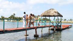 Group of fiends dancing salsa on pier over water Stock Footage