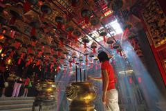 HONG KONG - 26 Jul, Man Mo temple in Hong Kong with many incense Stock Photos