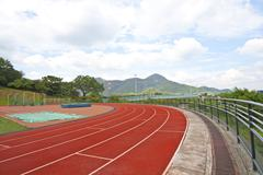 Sports stadium with running track at day Stock Photos