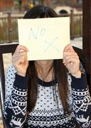 Woman holding NO signage - stock photo
