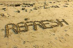 Refresh on sand Stock Photos