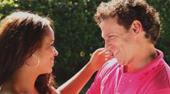 Bi-racial couple laughing & caressing Stock Footage