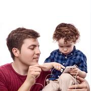 Stock Photo of teaching his son