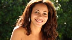 Biracial young woman smiling flirting to camera Stock Footage