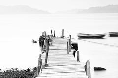 Wooden pier at low saturation - stock photo