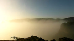 Photograph in action within magnificent misty sunrise in a beautiful rocky park - stock footage