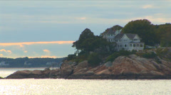 Beach House on Rocky Cliff Stock Footage