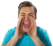 Exciting young handsome man shouting Stock Photos