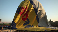 Hot air balloon is deflated after the flight, Luxor, Egypt Stock Footage