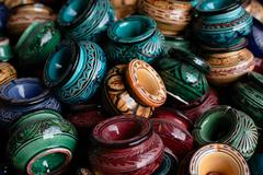Decorated ashtrays and traditional morocco souvenirs in medina Stock Photos