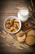 Muesli with low-fat milk and rusk Stock Photos