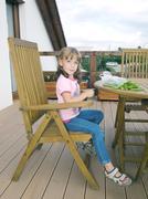 Girl eating peas - stock photo