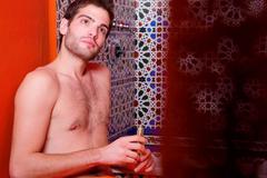 Man in the bathroom Stock Photos