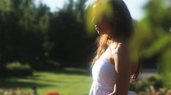 SLO MO MS PAN Teenage girl (16-17) walking through summer garden, Lehi, Utah, Stock Footage