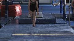 WS Female instructor assisting girl (10-11) exercising on bars, Orem, Utah, USA - stock footage
