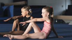 MS Two girls (6-7, 8-9) exercising in gym, Orem, Utah, USA Stock Footage