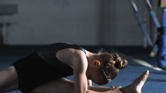 MS Girl (8-9) stretching in gym, Orem, Utah, USA Stock Footage