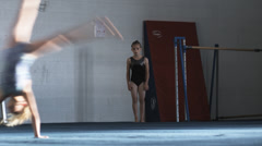 WS Girls (8-9, 10-11) doing somersaults in gym, Orem, Utah, USA Stock Footage